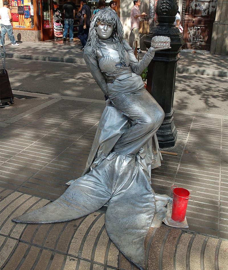 living statue fish lady