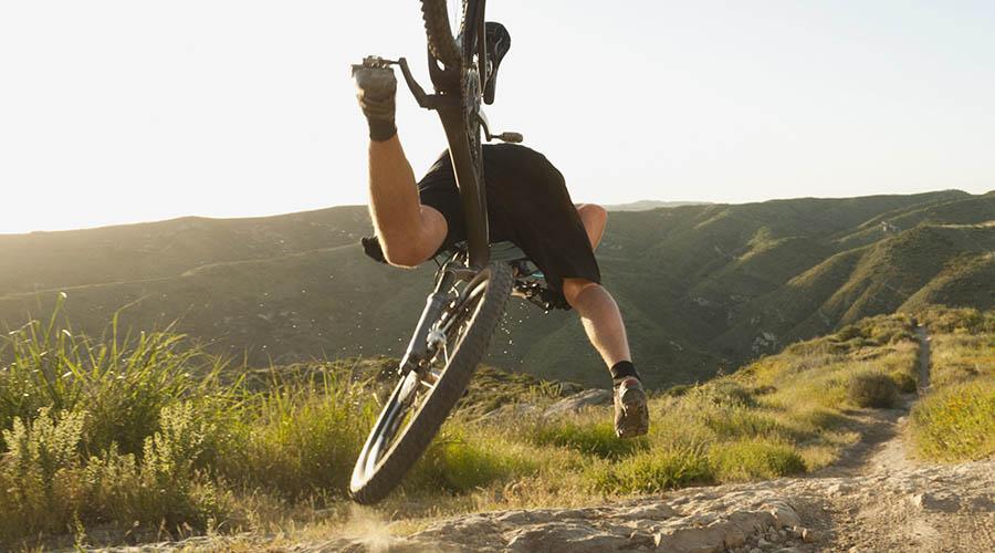 4 people falling off bikes