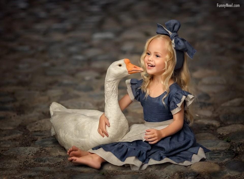 baby photography beautiful girl with duck