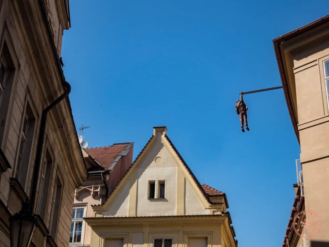 art installation man hanging out by david cerny