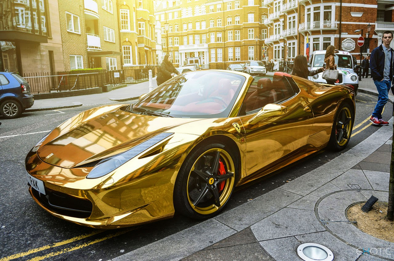 gold ferrari car
