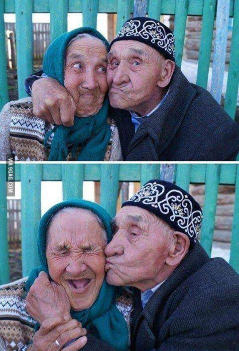 old age couple kissing funny