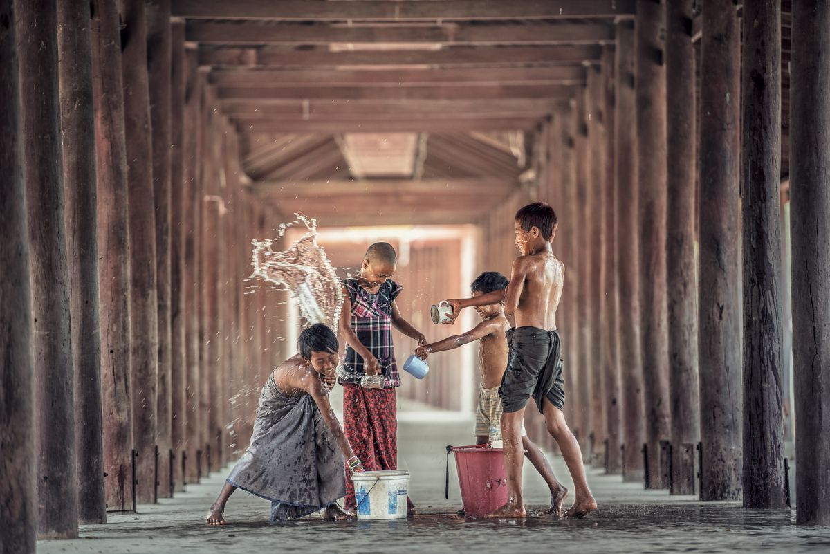 funny school photography kids playing water by sasin tipchai