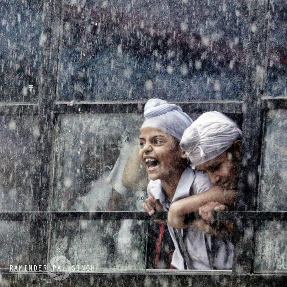 funny school pictures kids enjoying rain school bus by raminder pal singh