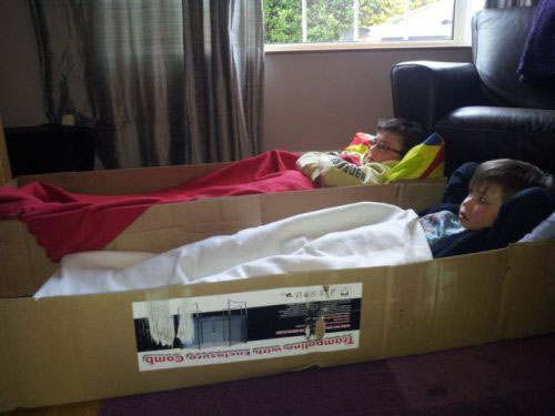 kids lying on cartoon box bed