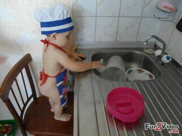 funny kid in kitchen
