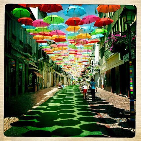 a street with colorful umberllas