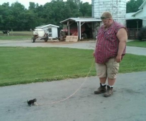 big man and small pet
