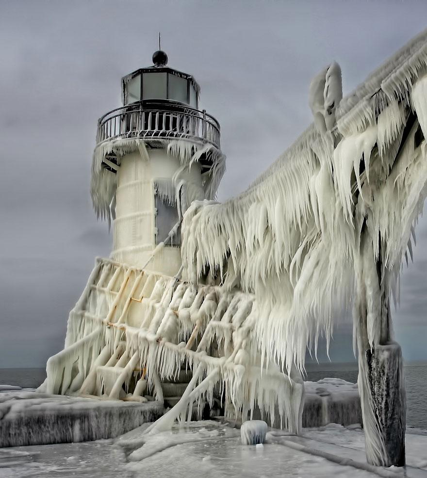 beautiful ice formation lighthouse lake michigan shore