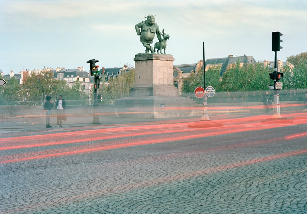 parisian monument kind ogre and companion benoit lapray