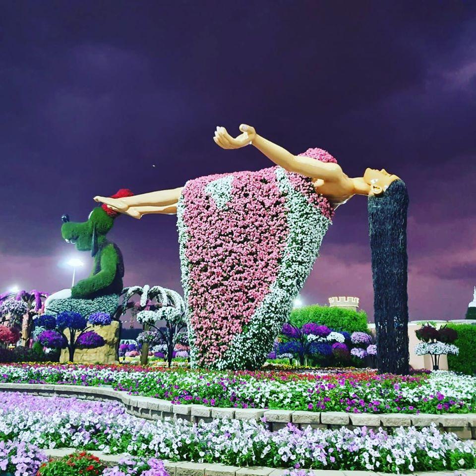 beautiful garden floating woman dubai miracle garden