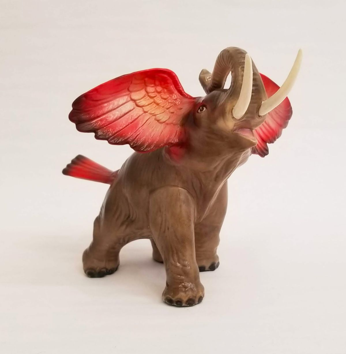 funny ceramic sculpture winged elephant debra broz
