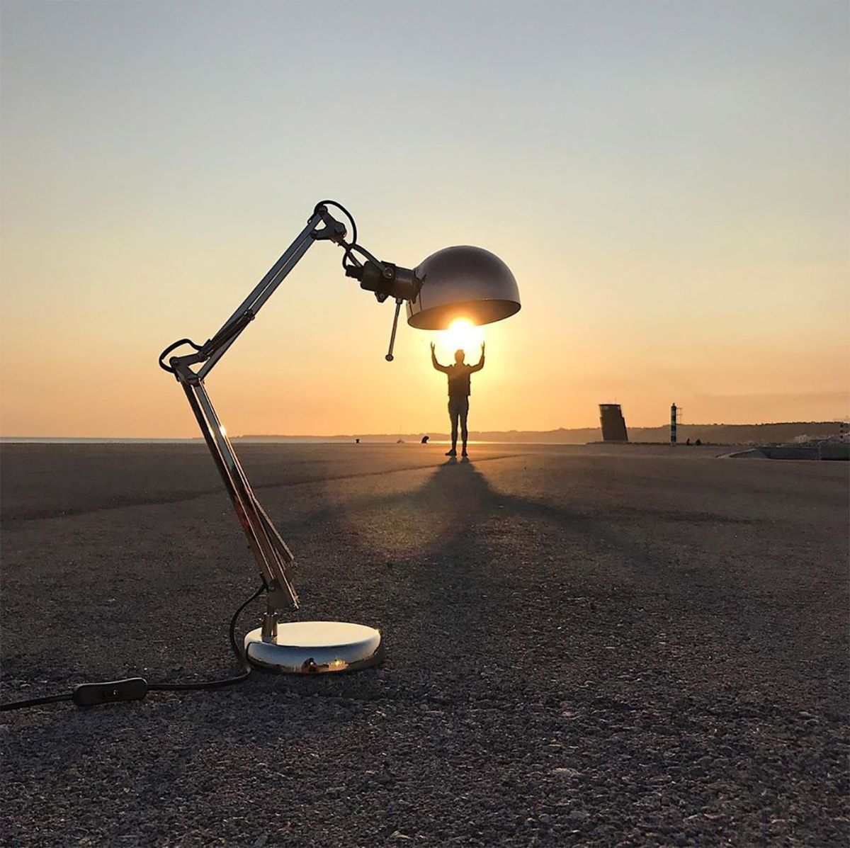 forced perspective photography man under lamp tiago silva